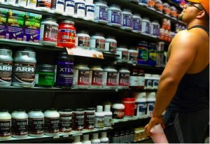 man in front of supplements
